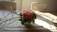 Vase with roses on the table Stock Footage