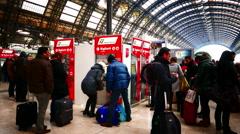 4K Milan Milano Garibaldi Central Train station passengers at ticket booth Stock Footage