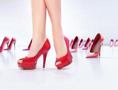Legs on the red high-heel shoes - stock photo