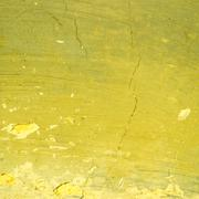 Yellow exposed concrete wall texture - stock photo