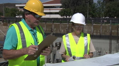Industrial designers corporate teamwork businesswoman construction site work Stock Footage