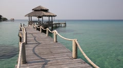Wooden pier and sea water on the beach. Island Koh Kood, Thailand Stock Footage