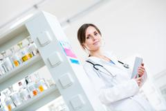 Pretty, female doctor in a hospital lab (image with copy space; - stock photo