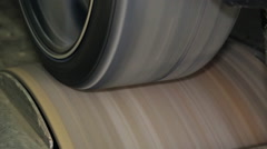 Car wheel spinning in the garage during chip tuning Stock Footage