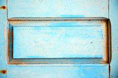 dirty stripped paint in    wood door and rusty nail - stock photo