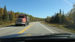 Autumn driving in Northern Ontario. Passing dump truck. Stock Footage