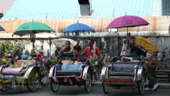 Rickshaws lined the street waiting for customers, George Town, Malaysia Stock Footage