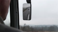 Bus Driver Driving In Rainy Weather On Highway And Looking At Left Mirror POV Stock Footage