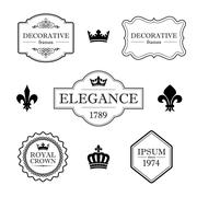 Set of vintage flourish frames, borders, crowns and fleur de lis design elements - stock illustration