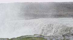 Waterfall Dettifoss in Iceland nature with people visiting tourist landmarks Stock Footage