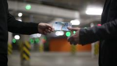 Men pass each other money euro banknotes and shake hands. Slow motion. Stock Footage