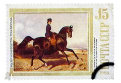 Stamp printed in USSR, shows Horsewoman Riding an Orlov-Rastopch Stock Photos