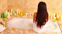 Woman relaxing at  bubble bath Stock Footage