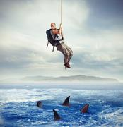 Explorer frightened by sharks - stock illustration