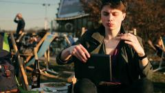 Student eating pizza and using tablet in outdoor bar Stock Footage