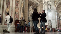 Visitors inside St. Peter's Basilica, Vatican. Stock Footage