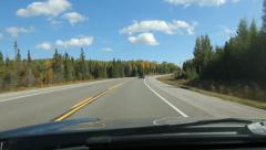 Autumn drive in Northern Ontario. Fluffy white clouds. Corner. Stock Footage