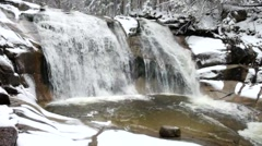 Winter view over foamy rapid stream into cascade of waterfal. - stock footage