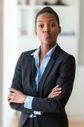 Portrait of a young African American business woman joking  - Black people Stock Photos