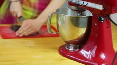 Breaking chocolate into pieces and food processor Stock Footage
