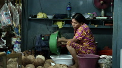 Woman extracting coconut in Sihanoukville Market. Stock Footage