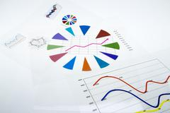 Stack of paper documents with financial reports and statistic information dat Stock Photos