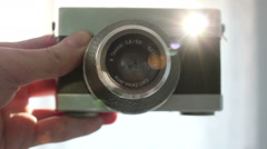 Old Camera With Sunflares In Viewfinder - stock footage