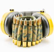 yellow ear protection and camouflage ammunition belt - stock photo