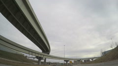 Vehicle shot of driving under several overpasses on a highway Stock Footage