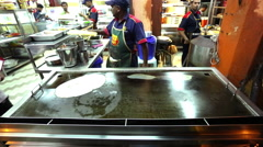 Stock Video Footage of Indian chef removed cooked unleavened bread, Indian restaurant