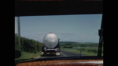 Car Passes Tanker Truck on English Country Road Stock Footage