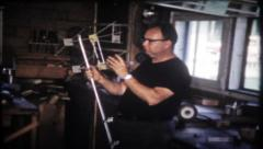 1936 - man working on television antenna in the workshop-vintage film home movie - stock footage