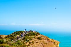 Tourists visiting the Twelve Apostles by the Great Ocean Road in Victoria, Austr - stock photo