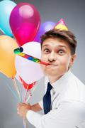 Young office manager holding baloons - stock photo