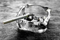 Stock Photo of Cigarette and ashtray