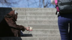 Homeless female begger begging Stock Footage
