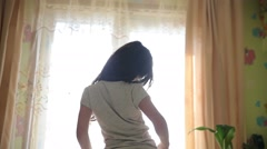 Teen girl stretches awake standing at window silhouette spin video hd 1920x1080 Stock Footage