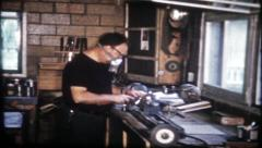 1935 - man working on home projects in garage workshop - vintage film home movie Stock Footage