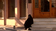 Islamic women covered in Jihab on steps Stock Footage
