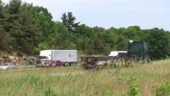 Big trucks and traffic driving down a highway. Stock Footage