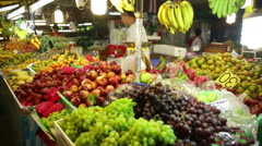 Market fruit counter filled with colorful fruits Stock Footage