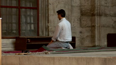 Islamic Man kneeling in prayer position at Mosque Stock Footage