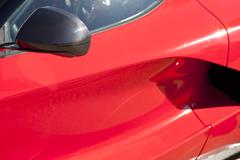 Red sports car wing mirror Kuvituskuvat
