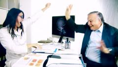 woman doctor and senior patient dancing in office happy - stock footage