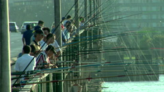 Local fishermen fishing on the Galata Bridge  - stock footage
