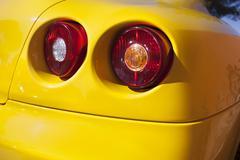 Yelllow sports car spot lights Stock Photos