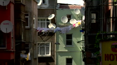 Stock Video Footage of Clothesline Satellite Dishes, homes Istanbul Turkey, colorful buildings Istanbul