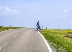 boy on a bicycle tour in Bavaria - stock photo