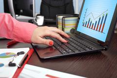 laptop with forex chart - stock photo