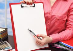 woman showing clipboard - stock photo